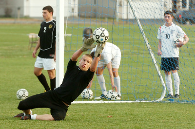 Goalie Aaron Costello blocks the soccer ball during their practice Monday afternoon in preparation for their game against Shenendehowa. Photo Erica Miller 11/9/09 spt_TogaSoccer3_Tues