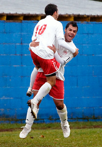 Waterford Halfmoon teammates Dylon Carlton  (air) and David Lee celebrate after scoring the second goal at their soccer game against Northern Adirondack Saturday afternoon in Queensbury. Photo Erica Miller 11/14/09 spt_WaterNAdk1_Sun