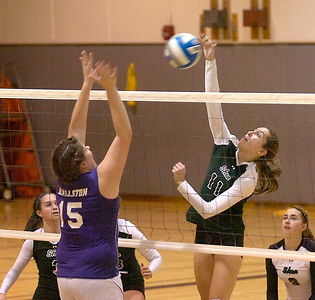 Shen's Kelsey Hanson goes up for a spike as Ballston's Marissa Traver goes up to defend during Thursday's semifinal in Burnt Hills. Ed Burke 11/5/09