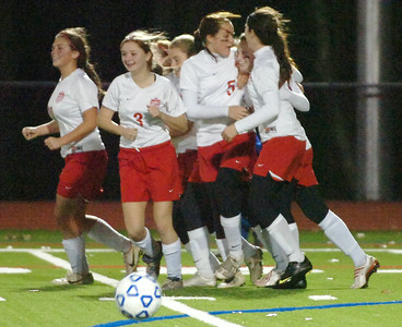 Mechanicville Varsity Girls soccer team in smiles after scoring their second goal of the game against Immaculate Heart Central during their Section III Class B state regionals in Stillwater. Photo Erica Miller 11/10/09 spt_MechIHC3_Wed