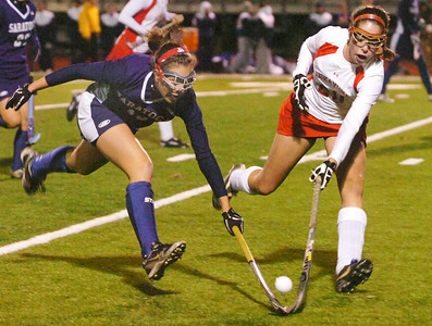 Carly Fuller, Saratoga, and Ritchie Assini, Niskayuna, battle for the ball during their field hockey game at Shenendehowa Friday evening. Photo Erica Miller 11/6/09 spt_NiskToga1_Sat