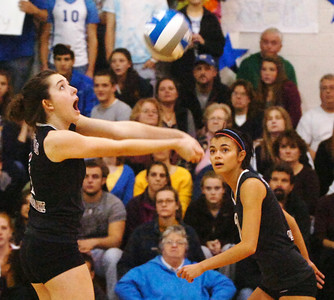 Natalie Ziskin, BH BL, hits the volleyball as teammate Amy Douglas carefully watches during their winning game Class A Finals against Queensbury at Lake George. Photo Erica Miller 11/11/09 spt_BHBLqueen2_Thurs