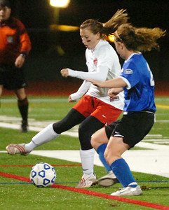 Alyssa Russesl, Mechanicville, and Emily Lalone, Immaculate Heart Central, battle for the soccer ball during their Section III Class B state regionals in Stillwater. Photo Erica Miller 11/10/09 spt_MechIHC2_Wed