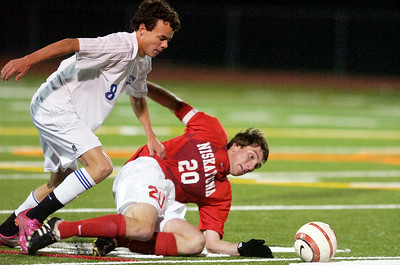 Niskayuna's Ryan Tauss is knocked to the ground as Saratoga's Bret Celeste regains possession of the ball during their winning Class AA sectional semifinals at Schuylerville High School. Photo Erica Miller 11/9/10 spt_TogaNisky2_Wed