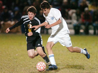 Steve Celeste of Saratoga kicks the ball down the field against Ballston Spa's Brett Gruener during their co-championship Sectional soccer game at Colonie, Saratoga winning in final penalty kick. Photo Erica Miller 11/10/10 spt_togabspa1_Thurs