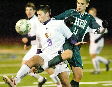 Ballston's Jeffrey West and Shen's Chris Schmid vie for the ball during Tuesday's Class AA soccer semifinal at Schuylerville. Ed Burke 11/9/10
