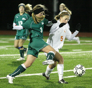 Shen's Katie Trainor winds up to try and beat Bethlehem's  Abbey Scro to the kick during the Section II Class AA girls soccer championship Wednesday at Stillwater. Ed Burke 11/10/10