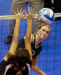 Burnt Hills-Ballston Lake's Lizzy Morton hits past Wantagh's Jenny Greenburg during the state volleyball championships Saturday at the Glens Falls Civic Center. Ed Burke 11/20/10