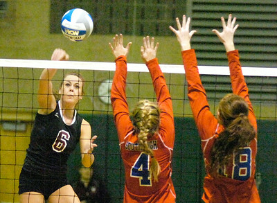 BHBL's Kaitlyn Valade hits past South High defenders Rachel Lumley, right, and Caitlin Herren during Tuesday's game at Shenedehowa. Ed Burke 11/9/10