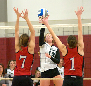 Shen's Hunter Drews hits into Baldwinsville defenders Sydnie Hamm (7) and Allegra Lee Bell during the Class AA Sectional Regional volleyball tournament Saturday at Union College. Ed Burke 11/13/10