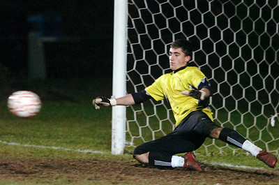 Ballston Spa Goalie Evan Mendez attempts to deflect a penalty kick during the penalty kicks at their co-championship section 2 Class AA soccer game Wednesday evening in Colonie. Photo Erica Miller 11/10/10 bspa_CoChamps5