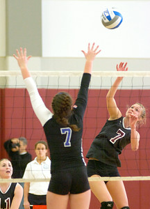 BHBL's Lizzy Morton hits over Cortnie Purce during the Class A Sectional Regional volleyball tournament Saturday at Union College. Ed Burke 11/13/10