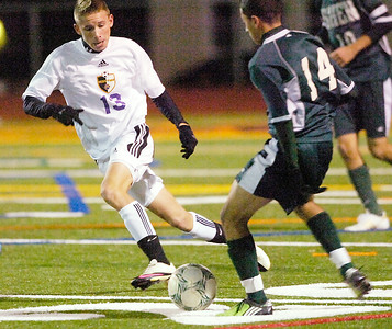 Ballston's Kevin Marin, left, and Shen's Sammi Teymouri battle for control of the ball during Tuesday's Class AA soccer semifinal at Schuylerville. Ed Burke 11/9/10
