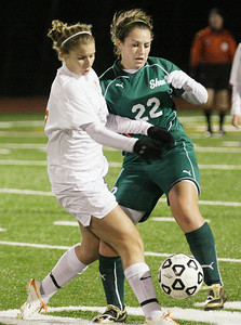 Bethlehem's Marjana Maksuti and Shen's Erin Luibrand battle for control of the ball during the Section II Class AA girls soccer championship Wednesdaty at Stillwater. Ed Burke 11/10/10