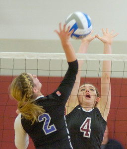 BHBL's Natalie Ziskin goes up to block a shot by Oswego's Siena Wilder during the Class A Sectional Regional volleyball tournament Saturday at Union College. Ed Burke 11/13/10