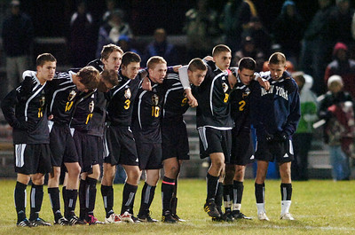 Ballston Spa teammates arm and arm line on the field during the penalty kicks at their co-championship section 2 Class AA soccer game Wednesday evening in Colonie. Photo Erica Miller 11/10/10 bspa_CoChamps4