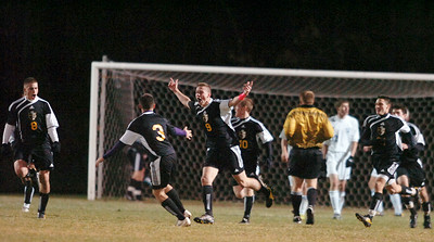 Ballston Spa's Connor Preece raises his arms in praise after scoring the first goal during the second half of their co-championship section 2 Class AA soccer game against Saratoga Wednesday evening in Colonie. Photo Erica Miller 11/10/10 bspa_CoChamps1