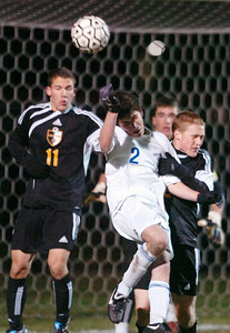 Eli Sterngass of Saratoga wins a battle for a header against Ballston Spa's Jon Marra (11) and Alex Johnson during their co-championship Sectional soccer game at Colonie, Saratoga winning in final penalty kick. Photo Erica Miller 11/10/10 spt_togabspa2_Thurs