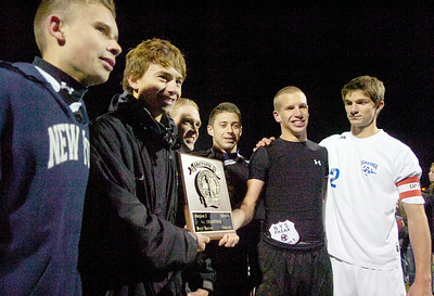 Saratoga and Ballston Spa captains hold their winning plaque after their co-championship Sectional soccer game at Colonie, Saratoga winning in final penalty kick. Photo Erica Miller 11/10/10 spt_togabspa5_Thurs
