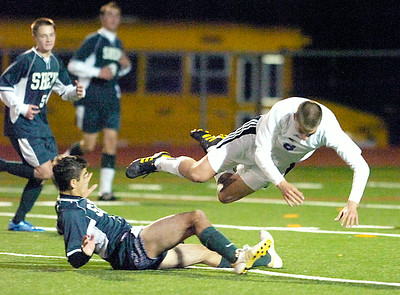 Ballston's Spa Lucas Audi goes airborne after tangling with Shen's Matt Silvi during Tuesday's Class AA soccer semifinal at Schuylerville. Ed Burke 11/9/10