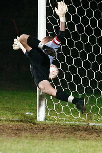 Saratoga Goalie Aaron Costello flies into the air defending the goal as the ball is kicked out of bounds by Ballston Spa during their co-championship Sectional soccer game at Colonie, Saratoga winning in final penalty kick. Photo Erica Miller 11/10/10 spt_togabspa3_Thurs