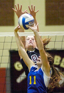 Burnt Hills-Ballston Lake's Victoria Dexter goes up to defend against Queensbury's Brooke Meader during the Spartans' Class A title win Thursday in Niskayuna. Ed BUrke 11/11/10