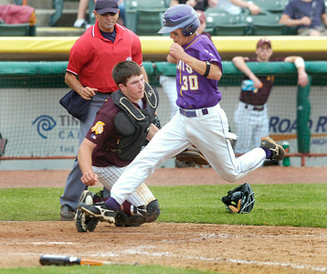 Saratoga Central Catholic's Shane Matthews scores past catcher Josh Nethaway of Fonda-Fultonville during Friday's Class B final in Troy. Ed Burke 6/5/09