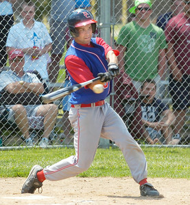 Maple's Hill's Mike Doughtie gets a base hit in the fourth inning, driving in teammate Shane McInerney,  during Saturday's win over Fort Plain in Saratoga Springs. Ed Burke 6/6/09
