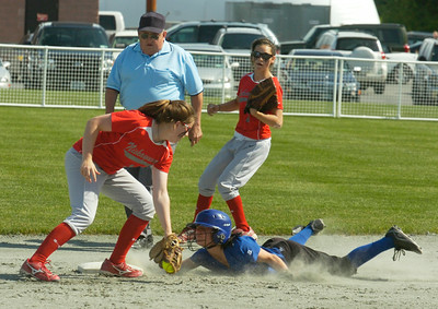 Saratoga's Alex Parisi is safe on a steal to second as Emily O'Donnell of Niskayuna gets a late tag during Tuesday's Class AA semifinal in Queensbury. Ed Burke 6/2/09
