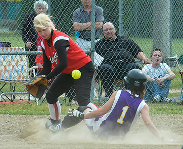 Duanesburg's Beth Smith is safe at third beating the throw to Christina Wilson of Waterford-Halfmoon during Wednesday's game at Clifton Common. Ed Burke 6/3/09