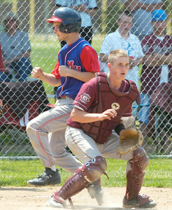 Fort Plain catcher Bo Baker waits for the throw as Maple Hill's Shane McInerney scores on a fourth inning hit by teammate Mike Doughtie during Saturday's win over Fort Plain in Saratoga Springs. Ed Burke 6/6/09