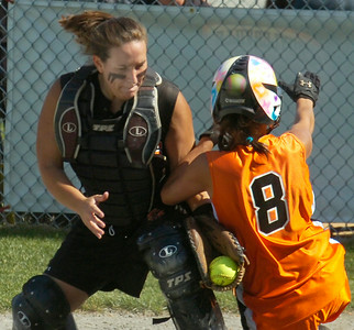 Schuylerville pitcher Brittany Thivierge tags out Taconic Hills' Alyssa VanAlphen at home during Tuesday's Class B semi-finals at the Adirondack Sports Complex in Queensbury. Ed Burke 6/2/09