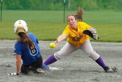 Saratoga's Krista Robarge is safe at second as Troy's Shannon Jones tries to bare hand a loose ball during Sectional softball action at Adirondack Sports Complex in Queensbury. Ed Burke 5/29/09