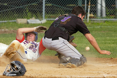 Driven in by teammate Leejay Pollacchi, Saratoga's Scott Hladik is safe at home as Amsterdam catcher Sean  Whitty chases a loose ball. Erich Lange was also driven in on the play. Ed Burke 5/29/09