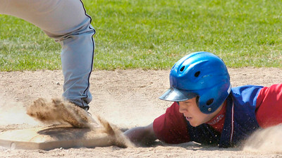 Maple Hill's Patrick Curtain dives safe back to first base during Saturday's win over Fort Plain at Geyser Park Field. Ed Burke 6/6/09
