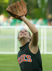Knowing her catch will propel Schuylerville into the Class B finals, Meagan McEachron grins broadly as she waits for a routine pop up off Taconic Hills' Alyssa VanAplhen to end the game Tuesday in Queensbury. Ed Burke 6/2/09