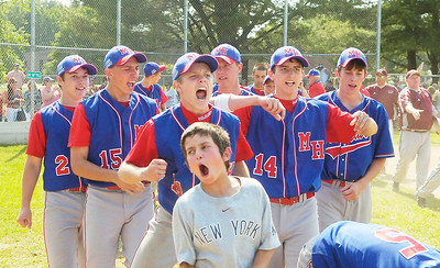 Maple Hill celebrates Saturday's 10-8 win over Fort Plain at Geyser Park Field in Saratoga Springs. Ed Burke 6/6/09