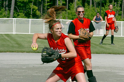 Mechanicville pitcher Anna Arceneaux fields a ground ball and throws to first for the out during Monday's Class B state regional game. The Red Raiders earned a 13-0 victory over Au Sable Valley. Click here to read coverage of this game. photo RICK GARGIULO 6-8-2009