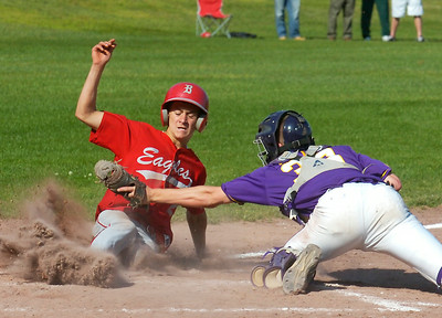 Beekmantown's  Luke Weaver slides safe under the tag by Saratoga Central Catholic catcher Jack Keller during Wednesday's regional playoff at Queensbury High School. CLICK HERE to read coverage from this game. Ed Burke 6/10/09
