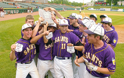 With patches and plaque in hand, the Saratoga Central Catholic Saints celebrate their Section II Class B win over Fonda-Fultonville Friday at The Joe. Ed Burke 6/5/09