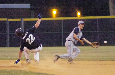 Stampede's Kyle Willmott comes in for a hard, but safe, landing at second as Patrick Foxton of Helmuth-Ingalls Post 232 reaches for the throw during Tuesday's game at East Side Rec. Ed Burke 7/6/10