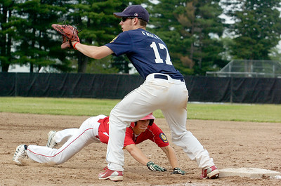Saratoga Stampede Luke Fauler waits for a pitch as Pat Briadamour, Hoxie, slides safely back to first base during their baseball game Saturday afternoon at Veterans Park. Photo Erica Miller 7/10/10 spt_Stampede4_Sun