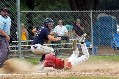 Hoxie's Pat Briadamour slide safely into home base as catcher Saratoga Stampede Jack Keller runs for the loose ball during their baseball game Saturday afternoon at Veterans Park. Photo Erica Miller 7/10/10 spt_Stampede5_Sun