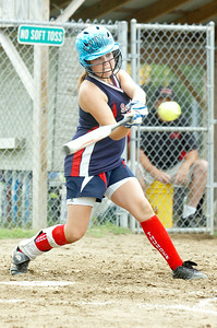 Saratoga Thunder Morgan Rumpf takes a swing at the bat during their softball game against The Rage Saturday morning at Veterans Park. Photo Erica Miller 7/10/10 spt_Thunder2_Sun
