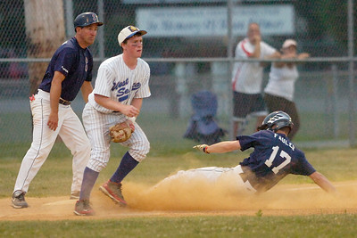 Stampede's Luke Fauler is safe at third as West Seneca's Pat Quinn waits for the throw during Thursday's game at East Side Rec. Ed Burke 7/8/10