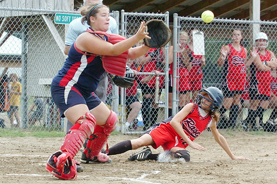 Jessy Juhlin, The Rage, slides safely into home as catcher Tucker Ragel (?) Saratoga Thunder awaits the ball during their Softball game Saturday morning at Veterans Park. Photo Erica Miller 7/10/10 spt_Thunder1_Sun