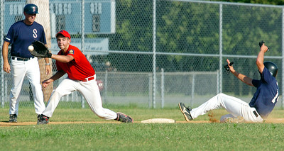 Chris Davis, Saratoga Stampede, slides safely into third base as Phil Casella, Granville, catches the ball during their baseball game at East Side Rec Wednesday afternoon. Photo Erica Miller 7/14/10 spt_StampdGran1_Thurs