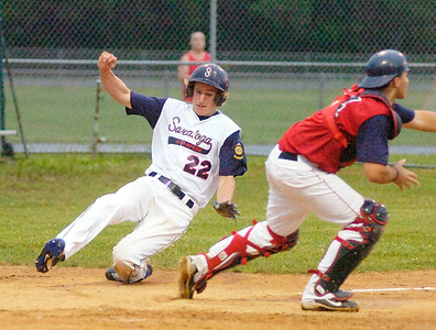 Saratoga Stampede's Kyle Willmott scores in the second inning as Anaconda Indian catcher Alex Jurczynski waits for the throw during Tuesday's game at East Side Rec. Ed Burke 6.22.10