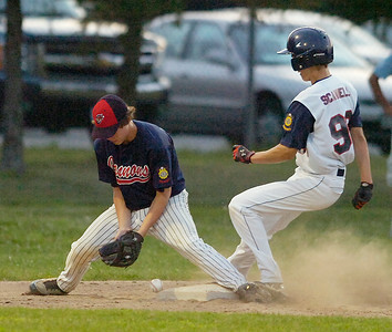 Colchester's Nick Lanphere reaches for the ball as Stampede's Brad Scammell is safe on a steal to third during Friday's game at Veterans Memorial Park. Ed Burke 6/25/10