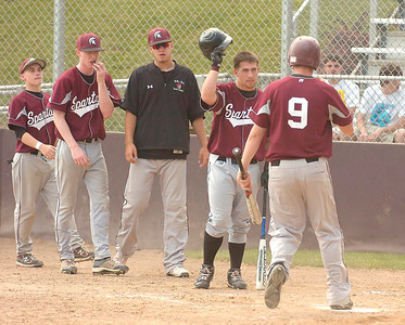 The Burnt Hill-Ballston Lake High School Spartans welcome teammate Dan Buff at home plate after he banged a second inning home run during their Class A regional win over Franklin Academy of Malone Tuesday at Bleeker Stadium in Albany. Ed Burke 6/7/11